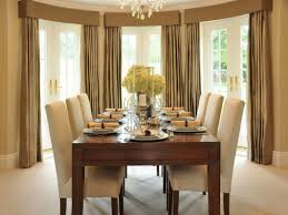 Formal Dining Room Decorating Ideas With Beautiful Flower Arrangement And Brown Drapes