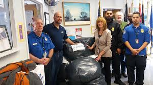 tsa officials at laguardia airport help clothe homeless veterans