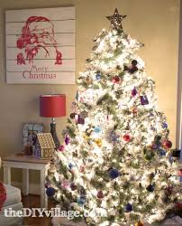 Flocked Christmas Trees Decorated by We Have A Thing For Trees Christmas Trees The Diy Village