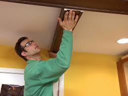 Hanging Drywall On Angled Ceiling by How To Install Faux Ceiling Beams How Tos Diy