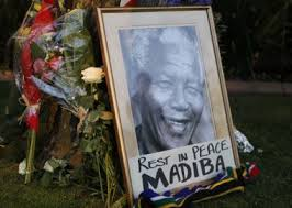 APA Framed Portrait Of Former President Nelson Mandela And Flowers Are Placed Outside Mandelas Johannesburg Home Friday Dec 6 2013 After The Freedom