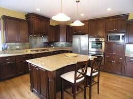 brown polihsed wooden kitchen cabinet and island with