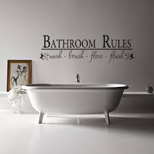 Guest Bathroom Wall Decor With Stickers And Small Framed Painting Behind Freestanding Bathtub