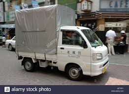 A Japanese Kei Delivery Truck With A Large Covered Box Cargo Area ...