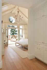 Coastal Bedroom With Vaulted Ceiling Chandelier And French Doors