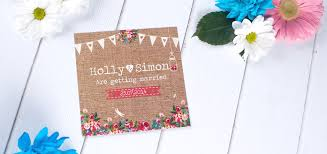 A Hessian Wedding InvitatIon With Bunting Mason Jars And Flowers