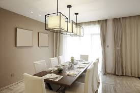 Contemporary Formal Dining Room With Modern Elements And Off White Drapes Layered Over Sheer