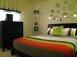 Couple Bedroom With Line Patterned Bed Cover And Pillows Round Frameless Mirror In Various Size For Decoration Ideas