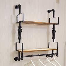Nicole Camry On A Wall Mounted Shelf Upscale Clothing Store Iron Pertaining To Racks