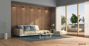 foto auf lager modernes wohnzimmer mit terrasse und blick auf das meer