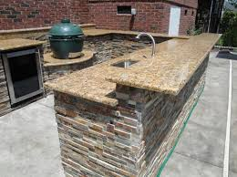 Dazzling U Shaped Outdoor Kitchen Designs With Sunset Gold Granite Countertop And Split Level Breakfast Bar Also Big Green Egg