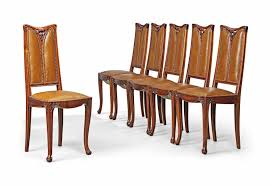 A SET OF LOUIS MAJORELLE (1859-1926) ART NOUVEAU CARVED WALNUT 'GUI ... Antique Vintage Art Nouveau Style Set Of 4 Carved Oak Ding Chairs Of Six French Louis Majorelle Caned Mahogany Unusual Victorian Walnut Wrought Iron Floral Lovely Important By Ernesto Basile For Ducrot 6 517550 Ding Chairs Art Nouveau Chair Set Sold Eight Period Tallback Stunning Inlaid High Back 2 Vinterior Fniture Antique Cupboards Tables