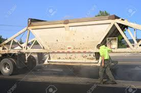 100 Belly Dump Truck A Large Delivers Fresh Asphalt For A Paving Stock