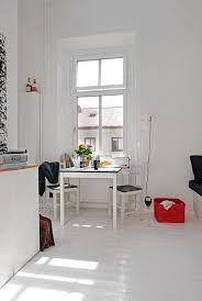 Apartements Fancy White Modern Studio Apartment Feature Square Table With Black Counter Top And Legs Mini Chairs Pedestal
