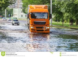 The Large Truck Goes On The Flooded City Street After The Strongest ...