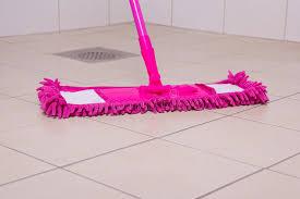 pink mop cleaning tile floor in bathroom stock image image 35050251