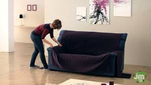 Sure Fit Sofa Covers Uk by How To Put An Universal Sofa Cover Youtube