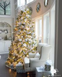 9 Foot White Gold And Silver Christmas Tree Filled With Ornaments In Two Story Great Room Front Of Bow Windows Check Out All The