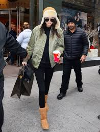 With Black Shirt Olive Green Jacket Leggings And Shearling Hat
