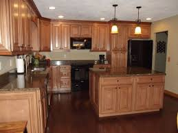 Maple Kitchen Cabinets With Dark Wood Floors Countertops