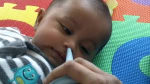 baby button nose and the bulb syringe