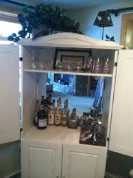 diy turn an old armoire into a home bar cabinet got this armoire