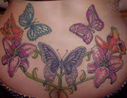 Butterflies And Flowers Lower Back Tattoo Design
