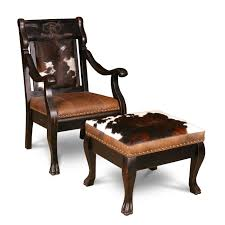 Rustic Animal Skin Inspired Accent Chair And Square Ottoman With Clawfoot Bases Legs