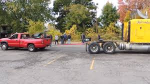 Semi Vs. Chevy Dually - Tug Of War - Watch Or Download | Downvids.net