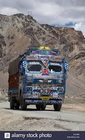 Decorated Indian Trucks Negotiate The Hazardous Manali-Leh Road High ...
