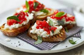 healthy canapes recipes tomato crostini topped with cottage cheese tesco food