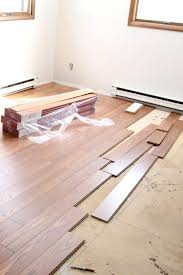 Installing Laminate Floors On Walls by Installing Laminate Flooring And A New Rug Too Bright Green Door