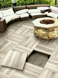 Elevated Patio Tile Floor By Serenissima With A Fire Pit Installed On It Top Outdoor Ideas