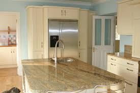 kashmir gold granite and white cabinets money pit