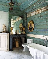 Turquoise Wood Paneling Complete With Authentic Layers Of Peeling Paint Is Alluring And Charismatic In This Rustic Bathroom
