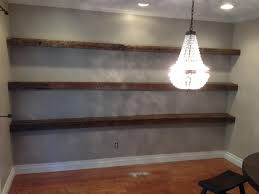 Superb Long Brown Barn Wood Floating Shelf On Grey Stucco Wall