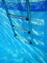A Step Ladder Swimming Pool Underwater Stock Photo