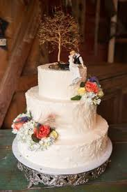 Love This Rustic Wedding Cake The Clever Decorator Used Our Look Of Sitting Couple