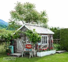 Rustic Garden Shed With Old Signs Tools And A Grapevine On FunkyJunkInteriors