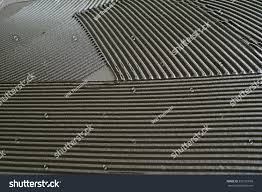 tile adhesive notched trowel patterns stock photo 333191699