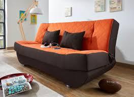 klick klack sofa mit dekokissen und bettkasten