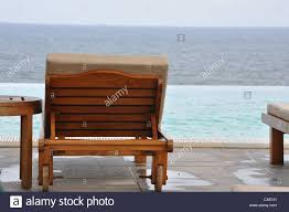 Lounge Chairs By An Infinity Pool Stock Photo: 50539105 - Alamy The Design Of This Lounge Chair Was Inspired By The Symbol For Caravan Sports Infinity Zero Gravity Recling Lounge Chair 608340 Best Folding Patio Chairs Outdoor Sport Set 2 Ebay Chairs An Finity Pool Stock Photo 539105 Alamy Portrait Of Woman Relaxing On By Pool Finity Lounge Armchair Armchairs From Ethimo Architonic 6 Collezione Braid Chair_artiture Genuine Ultimate Portable Comfort Canopy Loadstone Studio Rocking