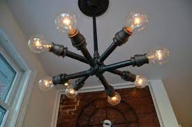 Black Pipe Light Fixture This Unique Has Two Layers Of Lights That Form A