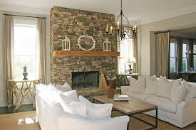 Stacked Stone Fireplace In The Rustic Living Room Complete With Sofa Decorated Various Kind Of Decoration Objects