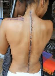 Beautiful Girl Shows Lovely Arabic Tattoo On Spine