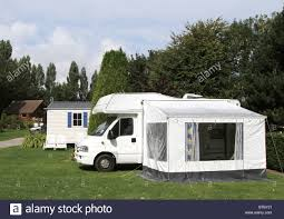 Motorhome With Midi-size Side Awning On A Woodland Caravan Park ... Outdoor Revolution Movelite Pro Carbon Midi Drive Away Motorhome Sunncamp Rotonde 350 Inflatable Air Frame Awning Awnings Caravan Window Blinds Chenille Door Parts Accsories For Your Motorhome Inserting In Side A Mazda Bongo Campervan With Side Awning On A Camp Site Near With Sides Alinum Under Decking Custom Built Amazoncom Rv Shade Trailer Universal Motordome Khyam Driveaway Classic Uk Camping From Wind Out Thule Give You Rodeo Sprint Campervan Annexe Drive Away