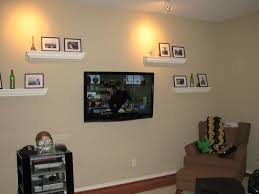 Tv On Gray Wallcombined With Wooden Living Mounted Shelves And Cabinet Storage Using