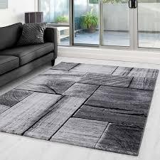 teppich modern designer wohnzimmer holzoptik mauer muster grau schwarz