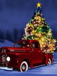 Tannenbaum Christmas Tree Farm Michigan by Shiny Red Truck In Snow With Christmas Tree Christmas