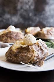 Baked Potatoes Might Seem Basic But These Salt Crusted With Roasted Garlic Rosemary Butter Are Anything Simple And Easy Yes